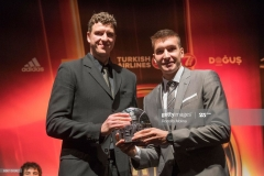 ISTANBUL, TURKEY - MAY 20:  Bogdan Bogdanovic, #13 of Fenerbahce Istanbul receive the First Team Trophy from Patrick Femerling, EuroLeague Basketball Ambassador during the 2016-017 Turkish Airlines EuroLeague Awards Ceremony at Ciragan Palace on May 20, 2017 in Istanbul, Turkey.  (Photo by Rodolfo Molina/Euroleague Basketball via Getty Images)