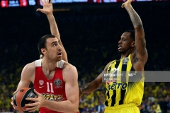 Olympiacos's Nikola Milutinov (L) vies with Fenerbahce's James Nunnally (R) during the first place basketball match between Fenerbahce and Olympiacos at the Euroleague Final Four basketball matches at Sinan Erdem sport Arena, on May 21, 2017 in Istanbul.  / AFP PHOTO / BULENT KILIC        (Photo credit should read BULENT KILIC/AFP via Getty Images)