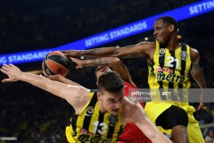 Olympiacos's Erick Green (C) fights for the ball against Fenerbahce's Bogdan Bogdanovic (L) and James Nunnally (R) during the first place basketball match between Fenerbahce and Olympiacos at the Euroleague Final Four basketball matches at Sinan Erdem sport Arena, on May 21, 2017 in Istanbul.  / AFP PHOTO / BULENT KILIC        (Photo credit should read BULENT KILIC/AFP via Getty Images)