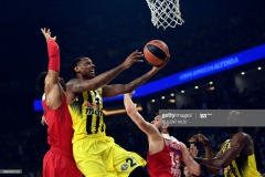 Olympiacos' Khem Birch (L) and Kostas Papanikolaou (2nd R) try to block Fenerbahce's  James Nunnally (2nd L) as he jumps foe the basket during the first place basketball match between Fenerbahce and Olympiacos at the Euroleague Final Four basketball matches at Sinan Erdem sport Arena, on May 21, 2017 in Istanbul.  / AFP PHOTO / BULENT KILIC        (Photo credit should read BULENT KILIC/AFP via Getty Images)