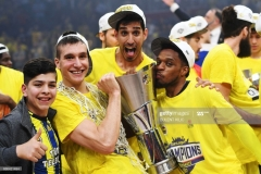 Fenerbahce's (from 2L) Bogdan Bogdanovic, Ahmet Duverioglu and Bobby Dixon pose with the trophy as they celebrate winning  the first place basketball match between Fenerbahce and Olympiacos at the Euroleague Final Four basketball matches at Sinan Erdem Sport Arena, on May 21, 2017, in Istanbul.  / AFP PHOTO / Bulent Kilic        (Photo credit should read BULENT KILIC/AFP via Getty Images)