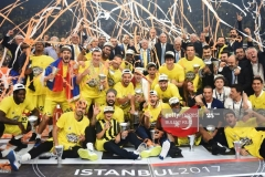Fenerbahce's players pose with the  trophy as they celebrate winning  the first place basketball match between Fenerbahce and Olympiacos at the Euroleague Final Four basketball matches at Sinan Erdem Sport Arena, on May 21, 2017, in Istanbul.  / AFP PHOTO / BULENT KILIC        (Photo credit should read BULENT KILIC/AFP via Getty Images)