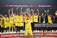 Fenerbahce's Melih Mahmutoglu (C) reacts with the trophy as he and teammates celebrate winning  the first place basketball match between Fenerbahce and Olympiacos at the Euroleague Final Four basketball matches at Sinan Erdem Sport Arena, on May 21, 2017, in Istanbul.  / AFP PHOTO / BULENT KILIC        (Photo credit should read BULENT KILIC/AFP via Getty Images)