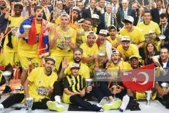 Fenerbahce's players celebrate winning  the first place basketball match between Fenerbahce and Olympiacos at the Euroleague Final Four basketball matches at Sinan Erdem Sport Arena, on May 21, 2017, in Istanbul.  / AFP PHOTO / BULENT KILIC        (Photo credit should read BULENT KILIC/AFP via Getty Images)