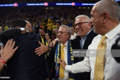 Fenerbahce president Aziz Yildirim (C) and Hurriyet daily journalist Ertugrul Kurkcu (2nd R) reacts after  Fenerbahce won the first place basketball match between Fenerbahce and Olympiacos at the Euroleague Final Four basketball matches at Sinan Erdem Sport Arena, on May 21, 2017, in Istanbul.  / AFP PHOTO / BULENT KILIC        (Photo credit should read BULENT KILIC/AFP via Getty Images)
