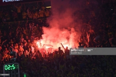 Fenerbahce's supporters burn flares as they celebrate their team winning the first place basketball match between Fenerbahce and Olympiacos at the Euroleague Final Four basketball matches at Sinan Erdem Sport Arena, on May 21, 2017, in Istanbul.  / AFP PHOTO / BULENT KILIC        (Photo credit should read BULENT KILIC/AFP via Getty Images)
