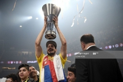 Fenerbahce's Nikola Kalinic holds the trophy as he celebrates winning  the first place basketball match between Fenerbahce and Olympiacos at the Euroleague Final Four basketball matches at Sinan Erdem Sport Arena, on May 21, 2017, in Istanbul.  / AFP PHOTO / OZAN KOSE        (Photo credit should read OZAN KOSE/AFP via Getty Images)