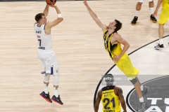 ISTANBUL, TURKEY - MAY 19: Luka Doncic, #7 of Real Madrid competes with Jan Vesely, #24 of Fenerbahce Istanbul  in action during the Turkish Airlines EuroLeague Final Four Semifinal A game between Fenerbahce Istanbul v Real  Madrid at Sinan Erdem Dome on May 19, 2017 in Istanbul, Turkey.  (Photo by Edu Candel/Euroleague Basketball via Getty Images)