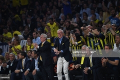 Fenerbahce's president Aziz Yildirim (C,L) and Turkish Hurriyet journalist Ertugrul Ozkok (C,R) react during the semi-final basketball match between Fenerbahce Ulker vs Real Madrid at the Euroleague Final Four basketball matches at Sinan Erdem sport Arena on May 19, 2017 in Istanbul.  / AFP PHOTO / BULENT KILIC        (Photo credit should read BULENT KILIC/AFP via Getty Images)