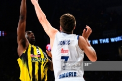 Fenerbahce Ekpe Udoh (L) goes for basket as Real Madrid Luka Doncic (R) tries to block him during the semi-final basketball match between Fenerbahce Ulker vs  Real Madrid at the Euroleague Final Four at Sinan Erdem sport arena on May 19, 2017 in Istanbul.  / AFP PHOTO / BULENT KILIC        (Photo credit should read BULENT KILIC/AFP via Getty Images)