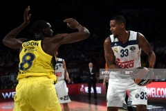 Real Madrid Trey Tompkins (R) vies with Fenerbahce Ekpe Udoh (L) during the semi-final basketball match between Fenerbahce Ulker vs Real Madrid at the Euroleague Final Four basketball matches at Sinan Erdem sport Arena on May 19, 2017 in Istanbul. / AFP PHOTO / OZAN KOSE        (Photo credit should read OZAN KOSE/AFP via Getty Images)
